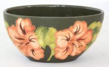Moorcroft Oval Vase with Coral Hibiscus Decoration on Green Ground. Factory marks to base. Height 8.5cm