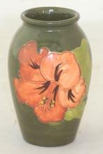Moorcroft Vase with Coral Hibiscus Decoration on Green Ground. Factory marks to base. Height 10.5cm