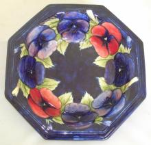 Moorcroft Octagonal Bowl with Poppy Decoration on Blue Ground. Factory Marks to Base. Height 2.25 inches, Diameter 10 inches.
