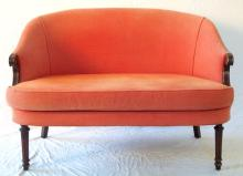 Edwardian Mahogany 2 Seat Sofa. Early 1900s. Upholstered in a heavy weave red fabric with scroll arms supported on turned fluted legs.  Height 30 in. Width 45 in.  Depth 27 in.