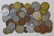World Coin Assortment. Canada, Dominican Republic, France, Great Britain, Ireland, Philippines are represented. One silver Canadian dime. Average circulated condition. 54 pieces.