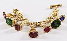 CHANEL, Très joli bracelet gourmette en métal doré orné de six pampilles en forme de cachet serties de pate de verre  bleu, vert et...