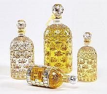 GUERLAIN, Quatre flacons de parfum dont trois au célèbre décor d'abeilles dorées. Parfum véritable pour les quatre. Parfait état, ja..