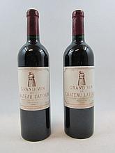 2 bouteilles CHÂTEAU LATOUR 1999 1er GCC Pauillac (étiquettes et capsules abimées)
