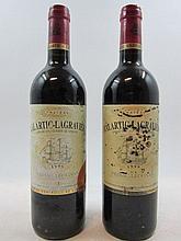 12 bouteilles CHÂTEAU MALARTIC LAGRAVIERE 1999 CC Pessac Léognan (étiquettes très abimées par l'humidité