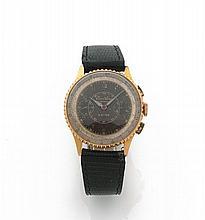 BREITLING CHRONOMAT, n° 461658, vers 1940 Rare chronographe bracelet en or rose 18K (750). Boîtier rond, lunette tournante avec...