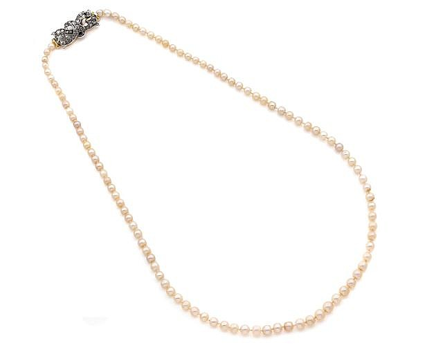 A 99 NATURAL PEARL NECKLACE