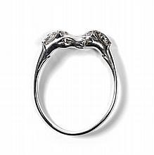HERMES Paris made in france Bracelet jonc en métal argenté, extrémités figurants des bustes de chevaux. Signé