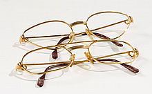 CARTIER, Deux paires de montures de lunettes, avec boite et carte. Etat d'usage. Two pairs of eyeglass frame, with box. State of use.