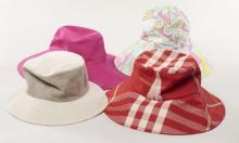 Lot de chapeaux : VERSACE, capeline fushia, T56 ; MOTCH POUR HERMES, bob beige, T57 ; BURBERRY, capeline en toile tartan rouge, T57...