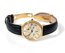 BREGUET QUANTIEME PERPETUEL, n° 3529, vers 2000 Belle montre bracelet à quantième perpétuel en or 18K (750). Boîtier rond. Fond...
