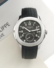 PATEK PHILIPPE AQUANAUT TRAVEL TIME, réf. 5164A-001, vers 2013 Belle montre bracelet à double fuseau horaire en acier. Boîtier c...