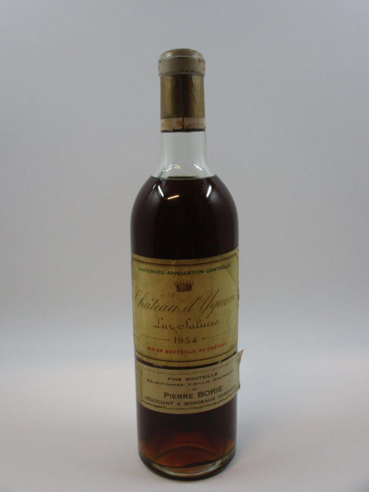 1 bouteille CHÂTEAU D'YQUEM 1954 1er cru Supérieur Sauternes (haute épaule. Etiquette abimée, tachée. Bouchon léger poussé, capsule ..