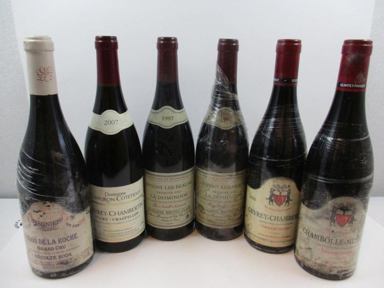 6 bouteilles 1 bt : CLOS DE LA ROCHE 2004 Grand cru. Michel Magnien (étiquette très abimée, sous film plastique)1 bt : GEVREY CHAMBE...