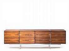 Ib KOFOD LARSEN 1921-2003 RARE BUFFET - CIRCA 1960 Piètement en acier, corps en palissandre et intérieur en acajou avec étagères rég...