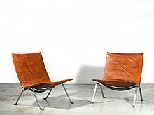 Poul KJAERHOLM 1929-1980 Paire de chauffeuses mod. PK 22 - 1955 Structure en acier plat brossé, assise et dossier recouverts de cuir...