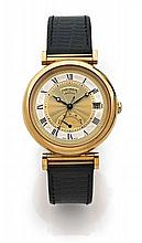 THEOREIN N°077 vers 1990 Belle montre bracelet en or. Boîtier rond, anses mobiles. Cadran deux tons gris et or avec chiffres rom...