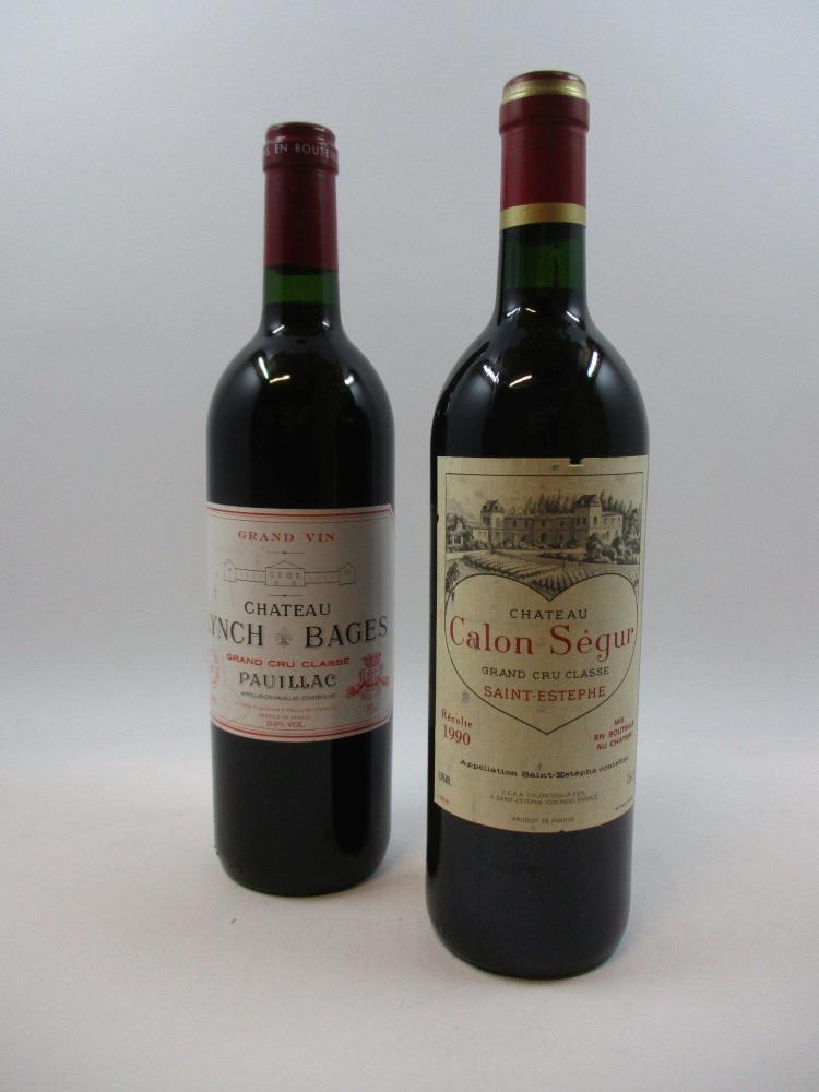 2 bouteilles 1 bt : CHÂTEAU LYNCH BAGES 2001 5è GC Pauillac (étiquette griffée)1 bt : CHÂTEAU CALON SEGUR 1990 3è GC Saint Estèphe (...
