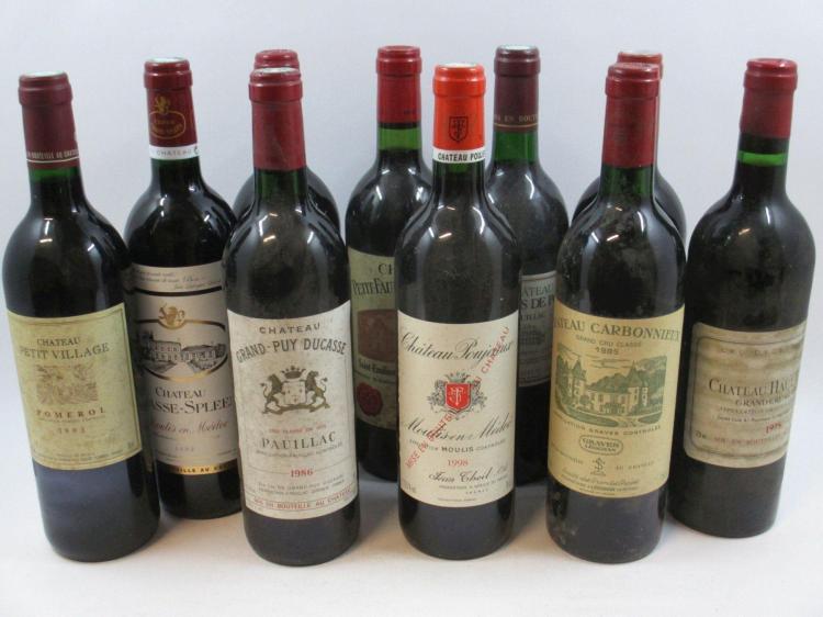 10 bouteilles 1 bt : CHÂTEAU PAVIE DECESSE 1990 GCC Saint Emilion (base goulot, étiquette tachée)1 bt : CHÂTEAU PETIT FAURIE SOUTARD...