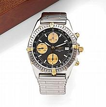 BREITLING CHRONOMAT, vers 1990 Chronographe bracelet en acier. Boîtier tonneau. Couronne et fond vissés. Lunette acier tournante...