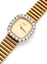 CHOPARD N° 50281, vers 1980 Belle montre bracelet de dame en or 18K (750). Boîtier tonneau. Lunette sertie de diamants. Cadran o...