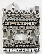 ARMAN (1928-2005) ACCUMULATION DE CULASSES SCIEES, 1969 Accumulation de culasses sur panneau en bois peint