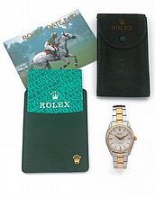 ROLEX OYSTER PERPETUAL, réf. 6567, vers 1959 Montre bracelet en or et acier. Boîtier rond. Couronne et fond vissés. Lunette stri...