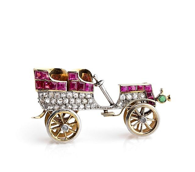 A YELLOW GOLD, WHITE GOLD  RUBY AND DIAMOND OLD CAR BROOCH