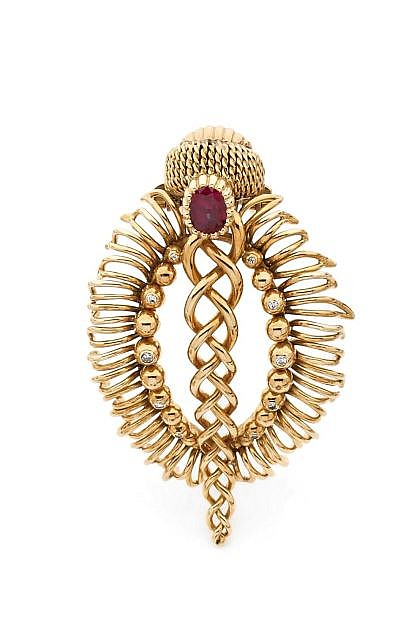 A DIAMOND, RUBY AND YELLOW GOLD CLIP, BY CARTIER