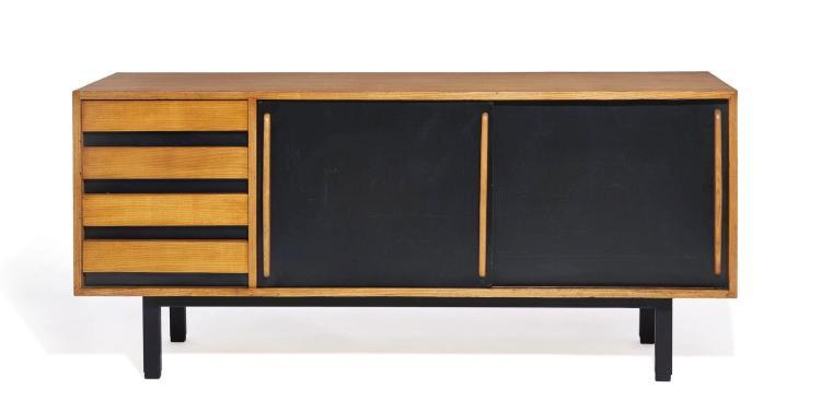 """Charlotte PERRIAND (1903-1999) Bahut dit """"Cansado"""" - 1958 Piètement en métal laqué noir, corps en bois et placage de bois, deux port..."""
