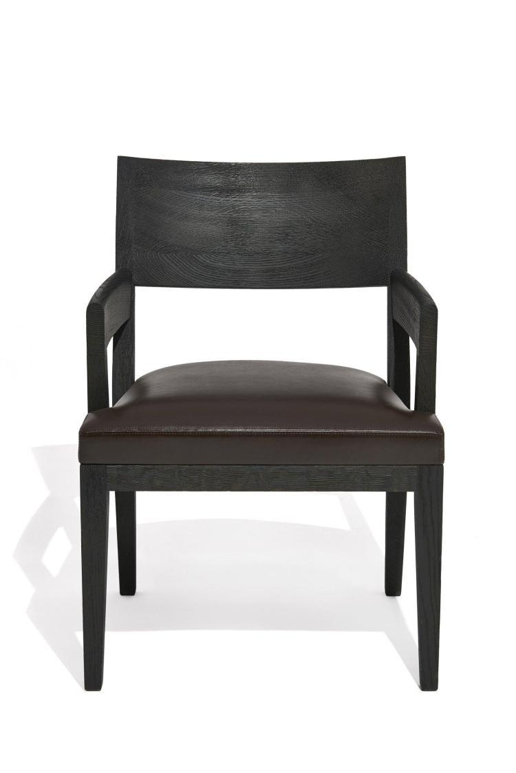 """Christian LIAIGRE (Né en 1945) Fauteuil dit """" Equus """" - Création 2008 Structure en chêne sablé noir, assise recouverte de cuir brun"""