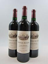 3 bouteilles CHÂTEAU AUSONE 2001 1er GCC (A) Saint Emilion (Etiquettes légèrement griffées, la majorité des bouteilles de cette cave...