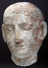 Etruscan Painted Limestone Portrait of a Young Man