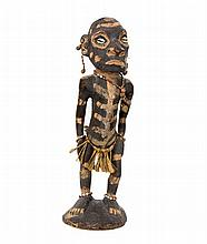 An old Asmat hand carved tribal figure