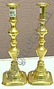 A pair of late 19th Century brass candlesticks