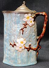 Majolica pitcher with tin lid