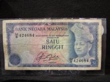 Vintage Malaysian $1 bank note.  Very interesting note in average condition.