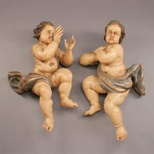Pair of Iberian Baroque Style Polychrome Painted Carved Figures of Putti