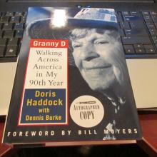 Dorris ''Granny D'' Haddock Signed Book........ (January 24, 1910 – March 9, 2010 was an American political activist from New Hampshire. Haddock achieved national fame when, between the ages of 88 and 90, starting on January 1, 1999, and culminating on February 29, 2000, she walked over 3,200 miles (5,100 km) across the continental United States to advocate for campaign finance reform. In 2004, she ran unsuccessfully as a Democratic challenger to incumbent Republican Judd Gregg for the U.S. Senate.  Haddock's walk across the country followed a southern route and took more than a year to complete, starting on January 1, 1999, in southern California and ending in Washington, D.C., on February 29, 2000.  Haddock requested a name change of her middle name to