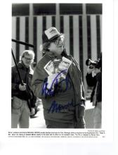 Michael Moore Autographed Photo....(born April 23, 1954) is an American documentary filmmaker, screenwriter, author, journalist, actor, and left-wing political activist. He is the director and producer of Fahrenheit 9/11 (2004), a critical look at the presidency of George W. Bush and the War on Terror, which is the highest-grossing documentary of all time and winner of the Palme d'Or. His film Bowling for Columbine (2002), which examines the causes of the Columbine High School massacre, won the Academy Award for Documentary Feature. Both Bowling for Columbine and Sicko (2007), which examines health care in the United States, are among the top ten highest-grossing documentaries. In September 2008, he released his first free movie on the Internet, Slacker Uprising, which documented his personal quest to encourage more Americans to vote in presidential elections. He has also written and starred in the TV shows TV Nation, a satirical newsmagazine television series and The Awful Truth, a satirical show.  Moore's written and cinematic works criticize topics such as globalization, large corporations, assault weapon ownership, U.S. Presidents Bill Clinton and George W. Bush, the Iraq War, the American health care system, and capitalism. In 2005 Time magazine named Moore one of the world's 100 most influential people.