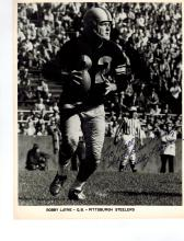 Bobby Layne Autographed Photo...... (December 19, 1926 – December 1, 1986) was an American football quarterback who played for 15 seasons in the National Football League. He played for the Chicago Bears in 1948, the New York Bulldogs in 1949, the Detroit Lions from 1950–1958, and the Pittsburgh Steelers from 1958–1962. He was drafted by the Bears in the first round of the 1948 NFL Draft. He played college football at the University of Texas.  He was inducted into the Pro Football Hall of Fame in 1967 and inducted into the College Football Hall of Fame in 1968. His number, 22, has been retired by the University of Texas Longhorns and Detroit Lions.