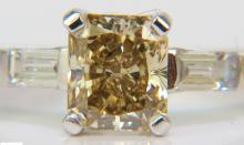 1.28CT FANCY YELLOW ORANGE DIAMOND RING VS