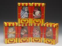 A miniature Pelham Puppet, brown Mouse, blue eyes, white body, pink velvet
