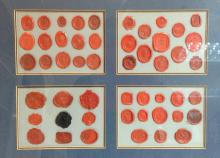 A collection of 18th, 19th, and early 20th century wax seals, various shape