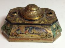 A late 19th century canted bombe shaped inkwell, decorated in the Chinoiser