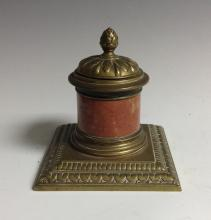 An early 20th century veined marble and brass columnar inkwell, hinged cove