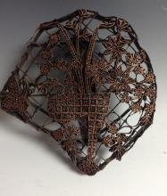 An Indian textile printing block, the filigree wirework with a basket of fl