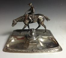 An Art Nouveau equestrian inkstand, by J P Kayser Sohn, surmounted by a rac