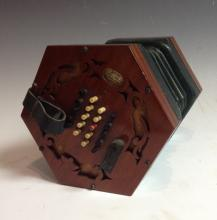 A 19th century mahogany concertina, by Rock Chidley, London, forty ivory ke