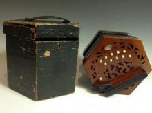 A Lachenal & Co. patent concertina, twenty one buttons, pierced hexagonal e